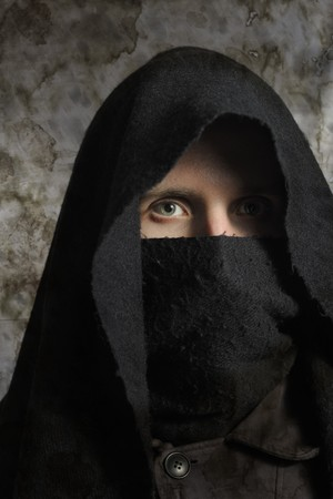 Portrait of assassin in darkness Stock Photo - 7100810