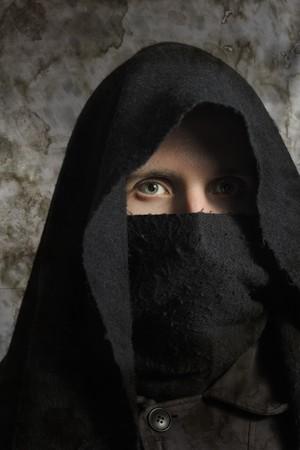 Portrait of assassin in darkness Stock Photo - 7100810