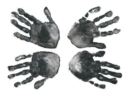 Spooky hands print over white background photo