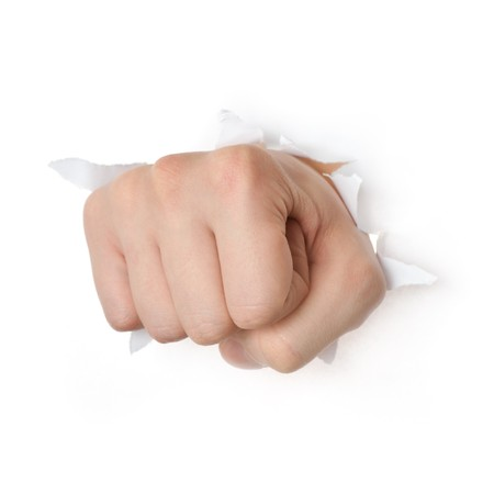 powerful creativity: Hand punching through paper isolated on white background  Stock Photo