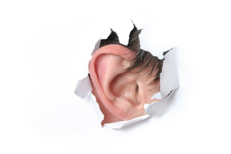 Ear in the hole of a paper Stock Photo - 7350115