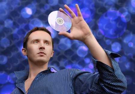 Man with compact disc in his hand photo