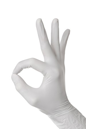 white glove: Hand gesture in glove isolated on white background