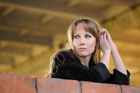 recline: Girl recline on brick wall Stock Photo