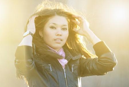 brune: Beautiful asian woman posing outdoors