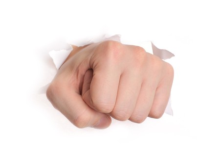 Hand punching through paper isolated on white background Stock Photo - 7548168