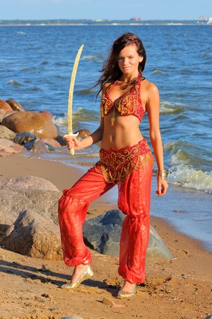 Woman in indian dress dancing with sabre photo