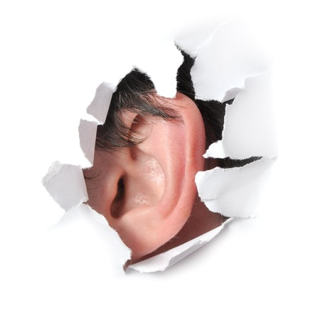 Ear in the hole of a paper Stock Photo - 7782292