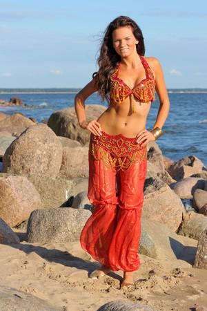 indian ocean: Woman dancing in red indian dress Stock Photo