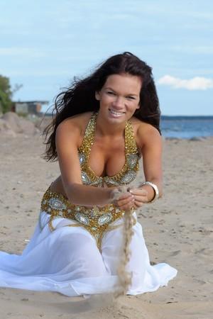 Beautiful woman play with sand photo