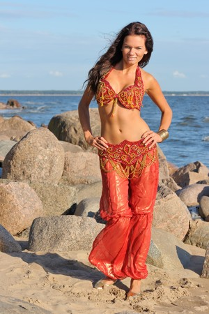 indian dance: Woman dancing in red indian dress Stock Photo