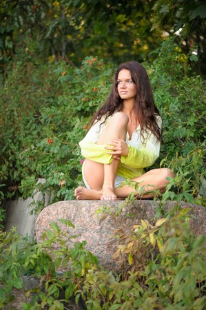 Woman sitting on the stones photo