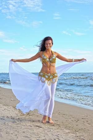 Beautiful woman in white exotic dress Stock Photo - 7955344