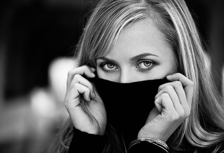 Blond woman hide her face photo