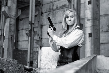 Woman with pistol in her hands photo