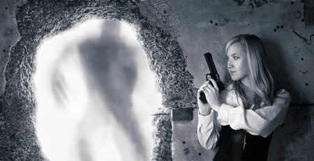 bounty: Woman bounty hunter with pistol in her hands Stock Photo