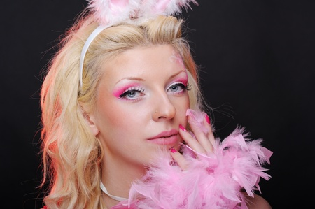 Female dressed up as rabbit cute girl in sexy playboy costume photo