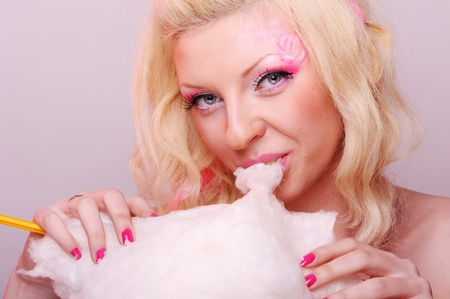 Woman with tasty cotton candy photo