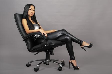 Beautiful asian woman sitting on armchair photo