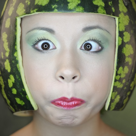 Woman with water-melon as helmet photo