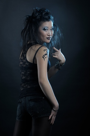 Gothic asian girl on black background photo
