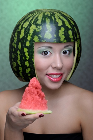 Woman with water-melon as helmet Stock Photo - 9302220