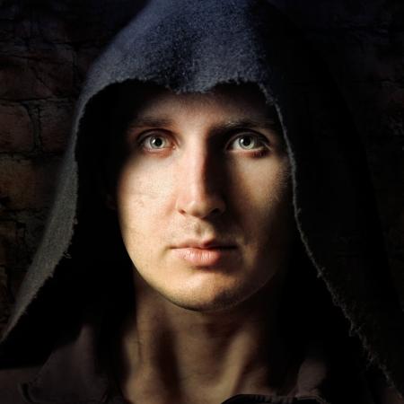 Spooky man in black hood photo