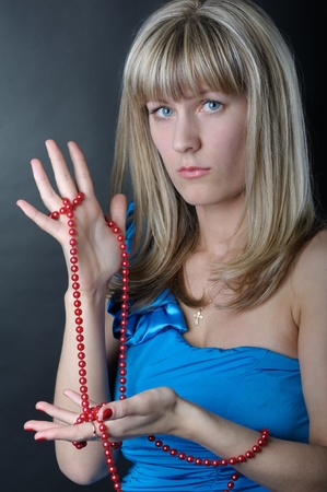 Woman in blue dress with beads photo