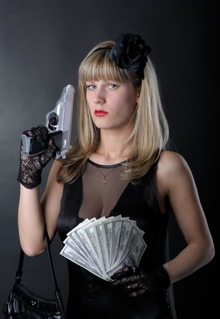 Gangster woman with pistol in black Stock Photo - 9528710