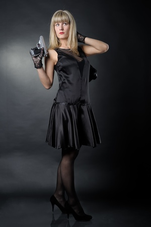 Gangster woman with pistol in black Stock Photo - 9528707