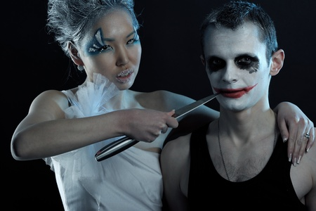 Spooky man and woman in darkness photo