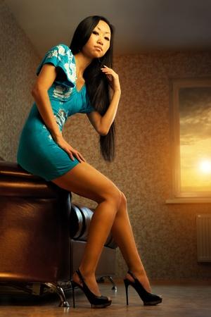 sexy asian woman: Beautiful asian woman relaxing on sofa Stock Photo