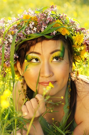 Asian woman in nature with chaplet on head photo