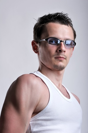 Man portrait in t-shirt and sunglasses photo
