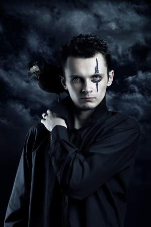 Spooky man with crow on his shoulder Stock Photo - 9960715
