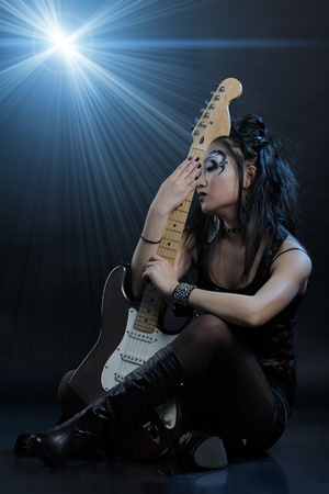 Woman rock star portrait with guitar photo