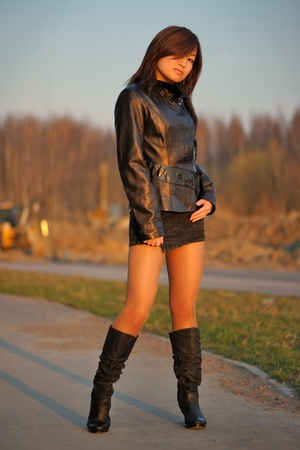 naughty girl: Young asian girl in jacket outdoor