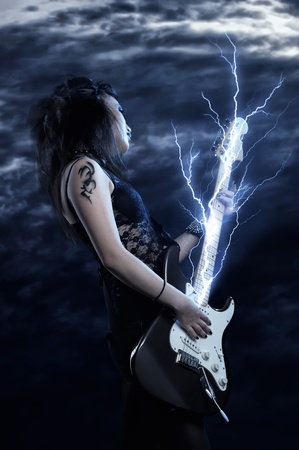 Woman rock star portrait with guitar Stock Photo