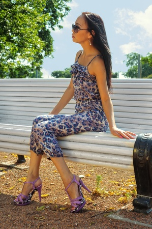 Asian woman sitting on the bench photo
