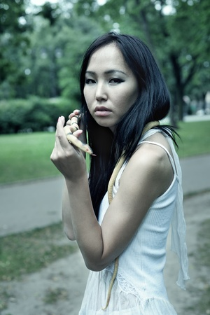 Asian woman with little snake photo