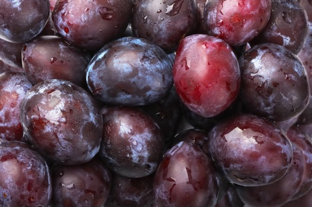 Plums fruit on the market for background photo