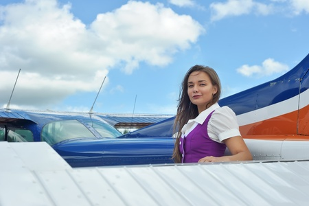 Woman posing near airplane outdoor photo