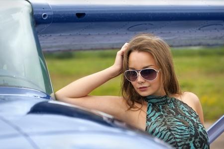 Woman posing near airplane outdoor photo