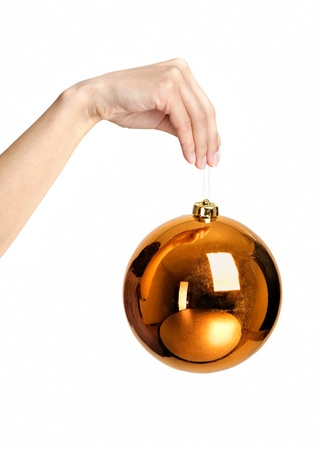 Christmas ball toy in hand isolated on white photo