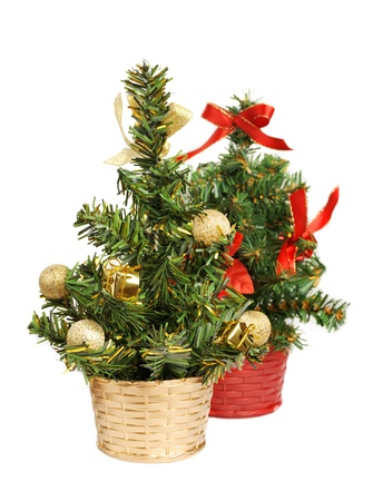 Two christmas tree with decorations isolated on white background photo