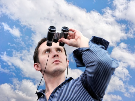Man with field-glass over clouds Stock Photo - 12332643
