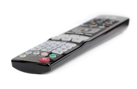 Black remote control isolated on white photo