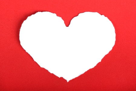Heart shape symbol over red paper photo