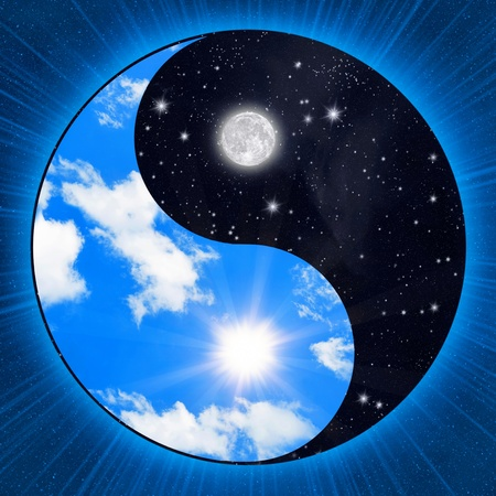 Yin yang symbol wigh clouds and stars photo