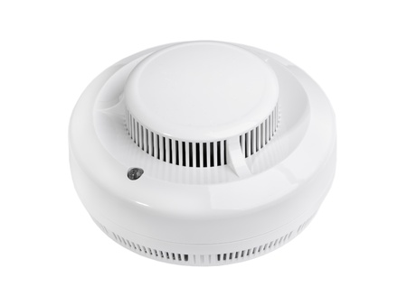 safe and sound: Smoke alarm isolated on white